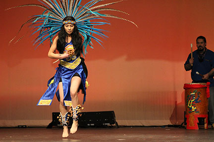 Jaira Amaya dances to the beat of the drum in Highland's Talents and Traditions assembly.
