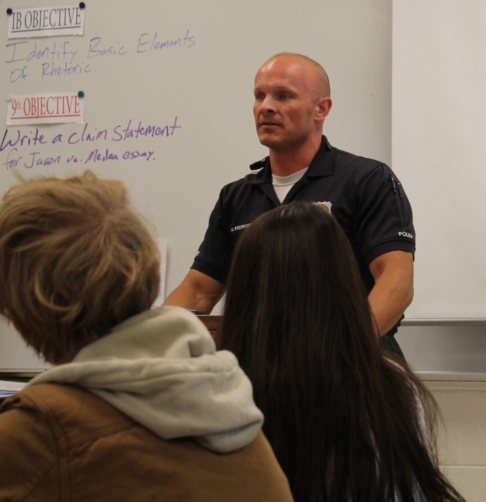 Officer Pedersen talking to students in a classroom.