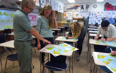 Teacher Kyle Bracken works closely with senior Elizabeth Cook.