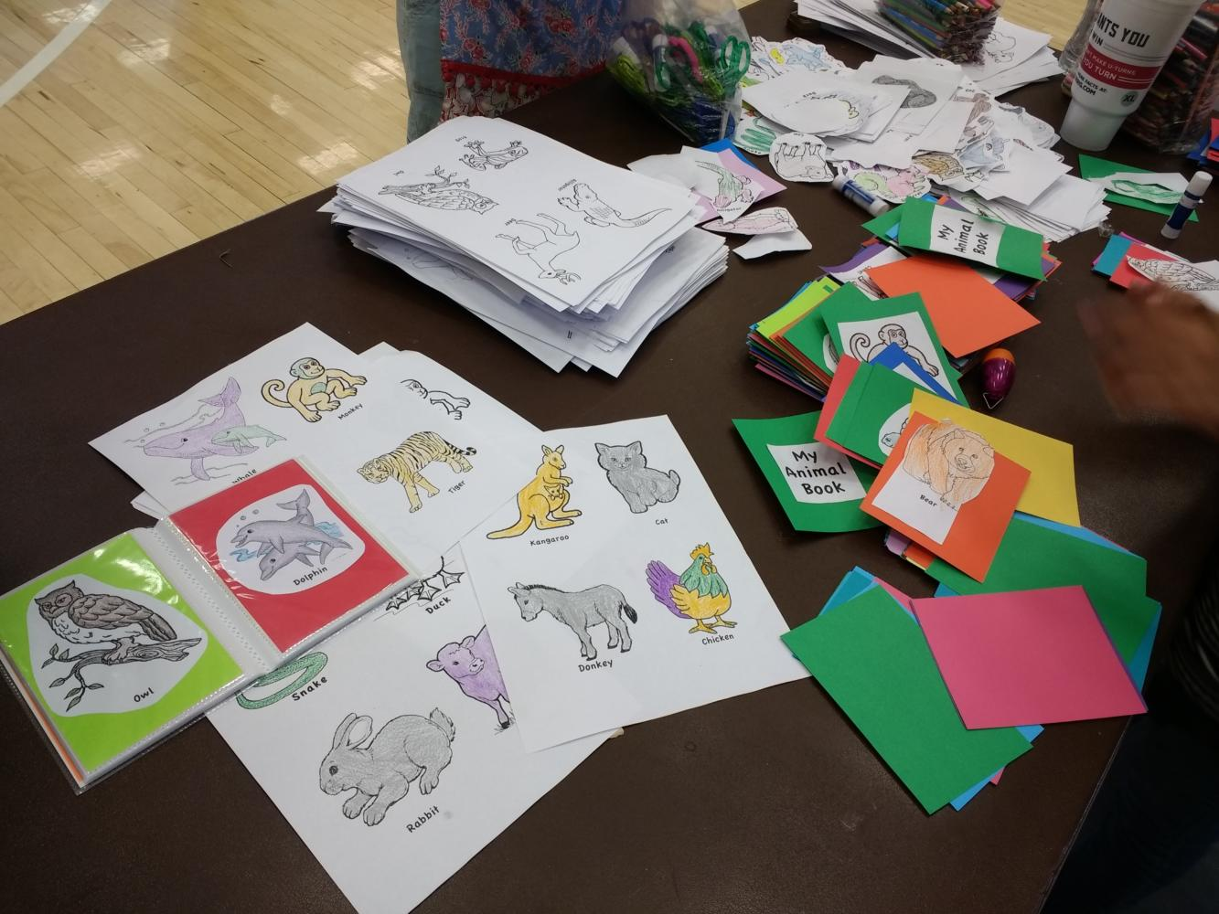 Books of animals colored by highland students made to help refugee children learn english.