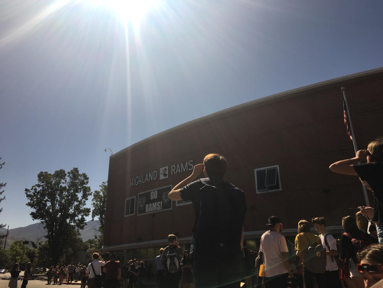 Highland students watch as solar eclipse becomes visible.