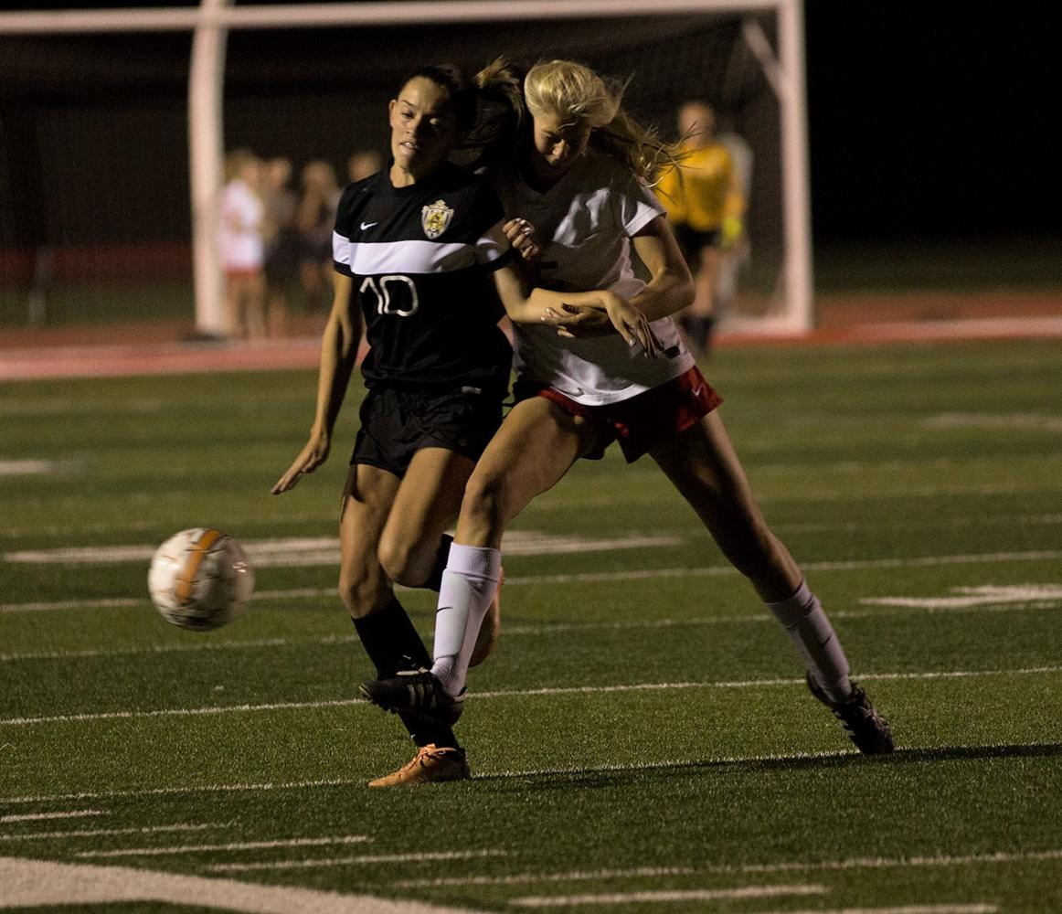 Sydney Pujol fights off an East defender and tries to push towards the goal.