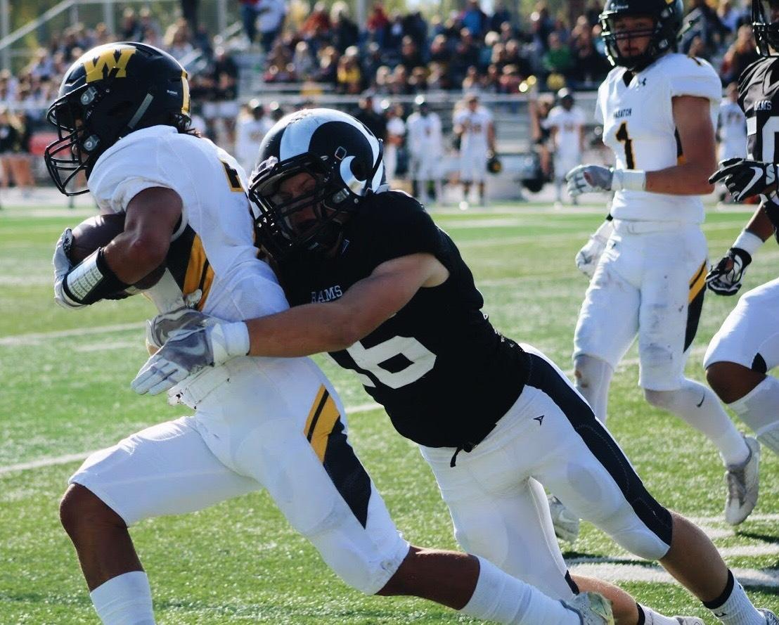 Junior Brennen Going tackles a Wasatch offensive player.