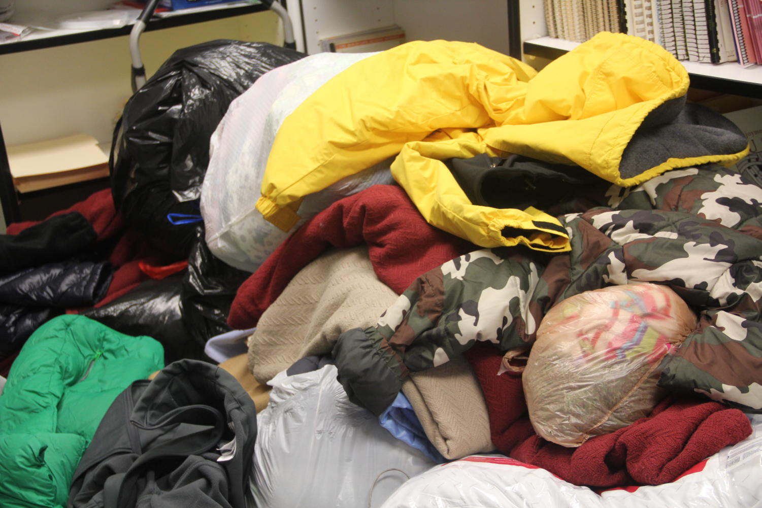 The clothing items donated almost covered the entire floor of the closet where they were held.