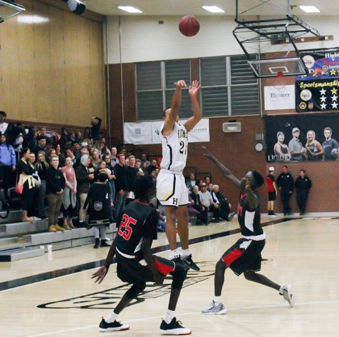 Senior Elijah Shelton shoots a 3-pointer against the West High Panthers.