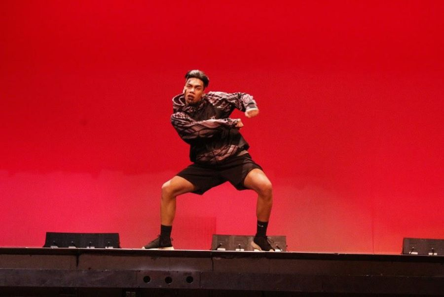 Trey+Tuitau+performs+his+original+dance+at+the+Talent+and+Traditions+assembly.