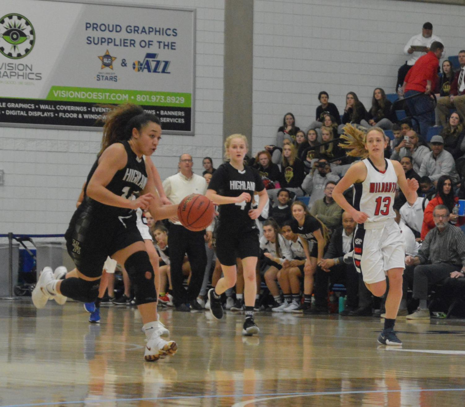 Senior Misini Fifita runs down the court in an attempt to score for Highland.