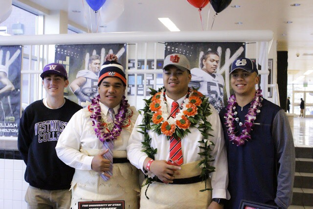 Pakofe+%28left%29%2C+Lotulelei%2C+and+Shelton+%28right%29%2C+pose+for+the+camera+after+signing+their+papers+to+play+college+football