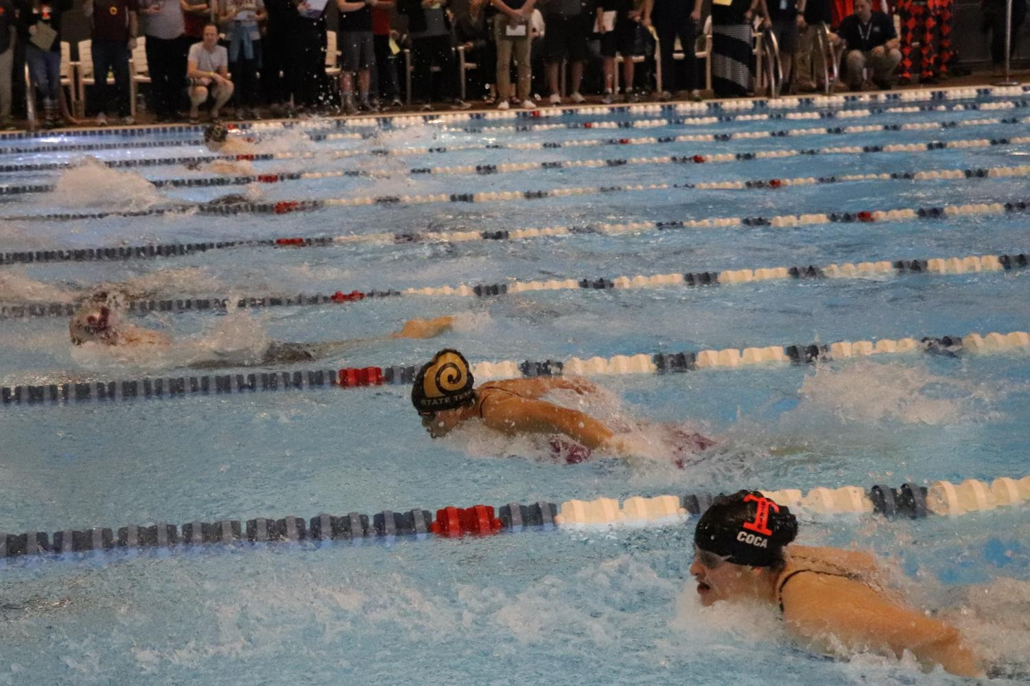 Highland swimmer Kara Ngu participates in the 100 meter butterfly race at Highland's state championship meet.