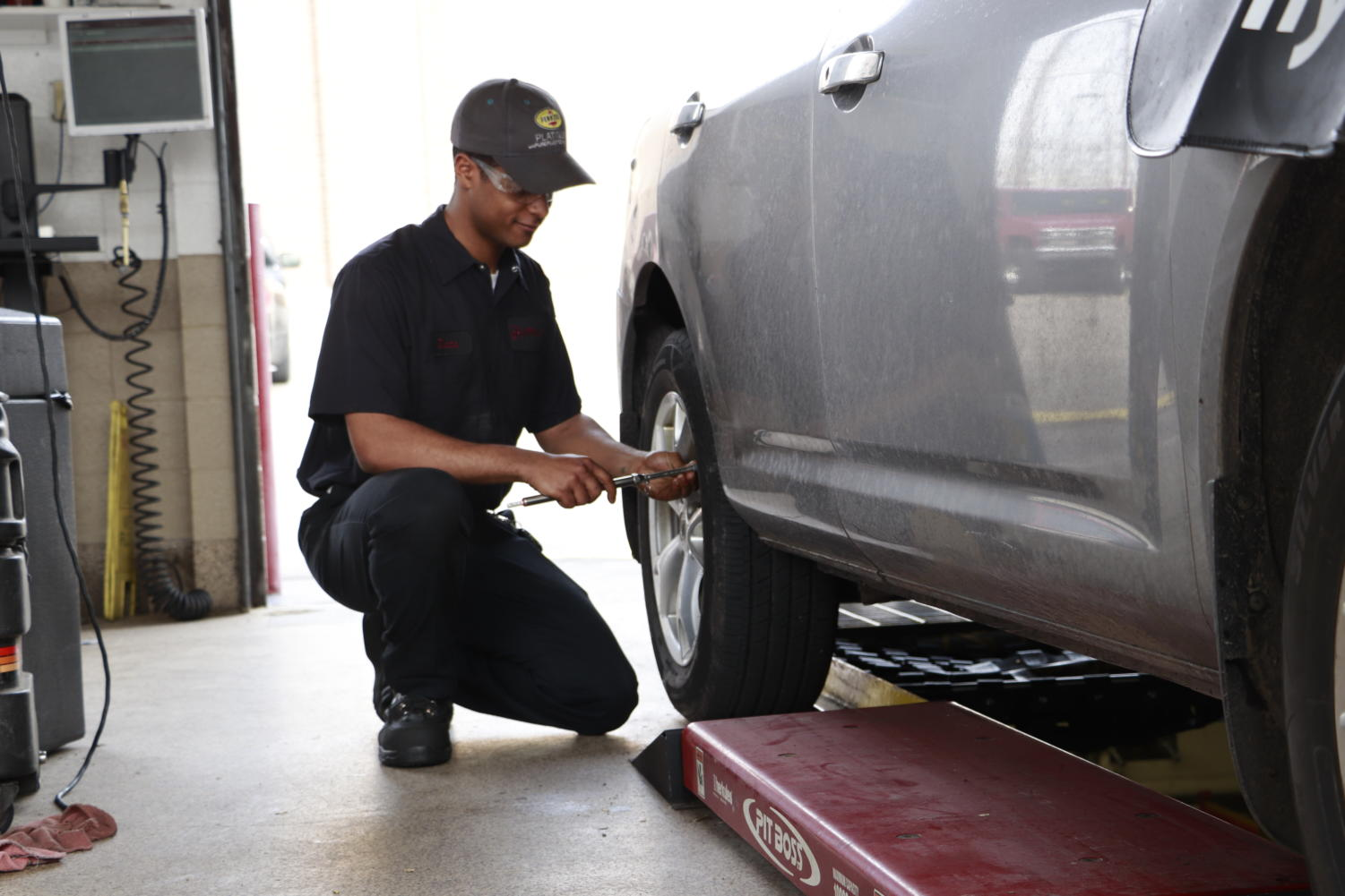 Diata Whitfield works on a car at Jiffy Lube