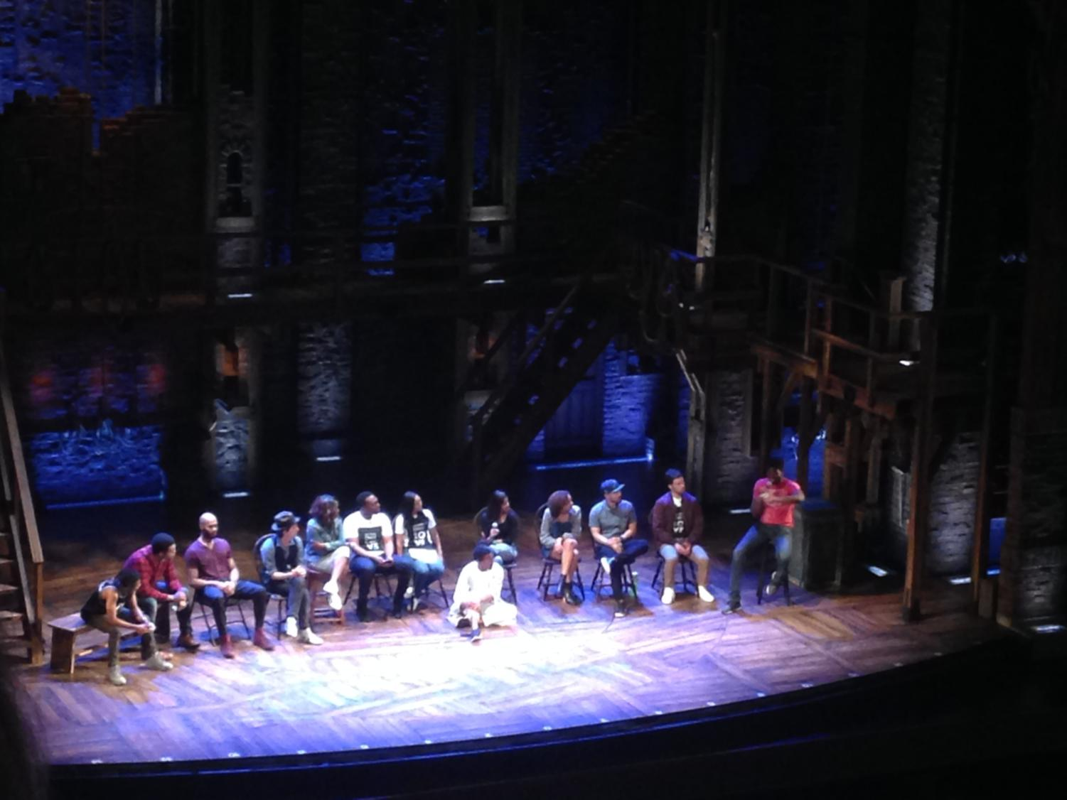 The cast of Hamilton answer students' questions during a part of a special field trip to see a matinee performance of the musical.