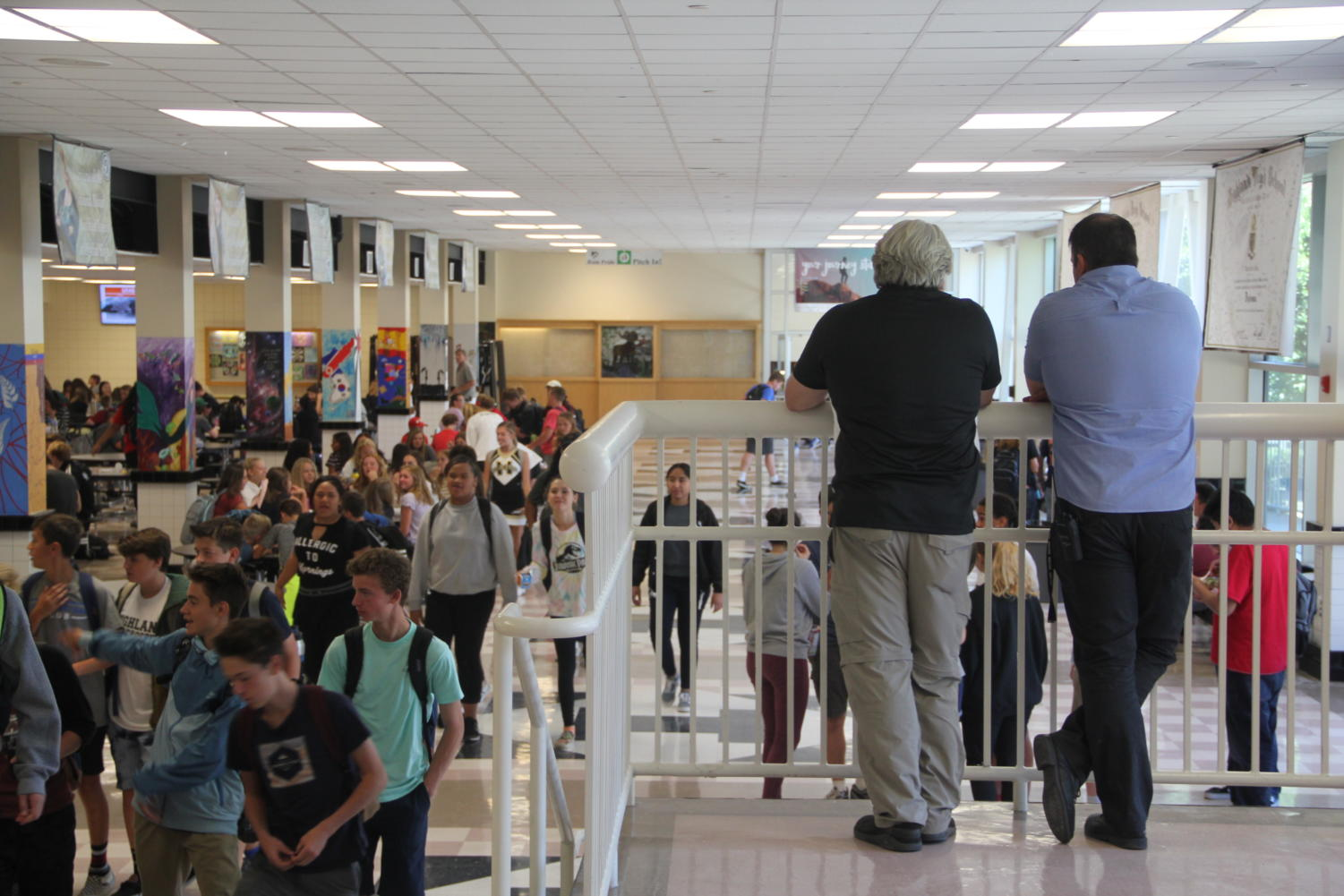 Principal Chris Jenson and vice principal Jon Jensen watch over the cafeteria during lunch.