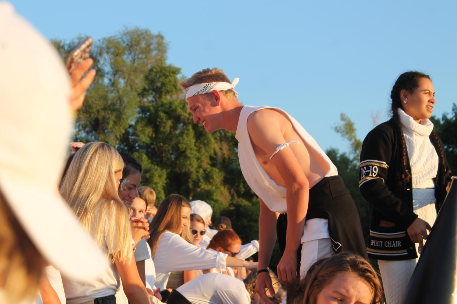 SBO President Will Dale  hypes up the crowd during a footall game.
