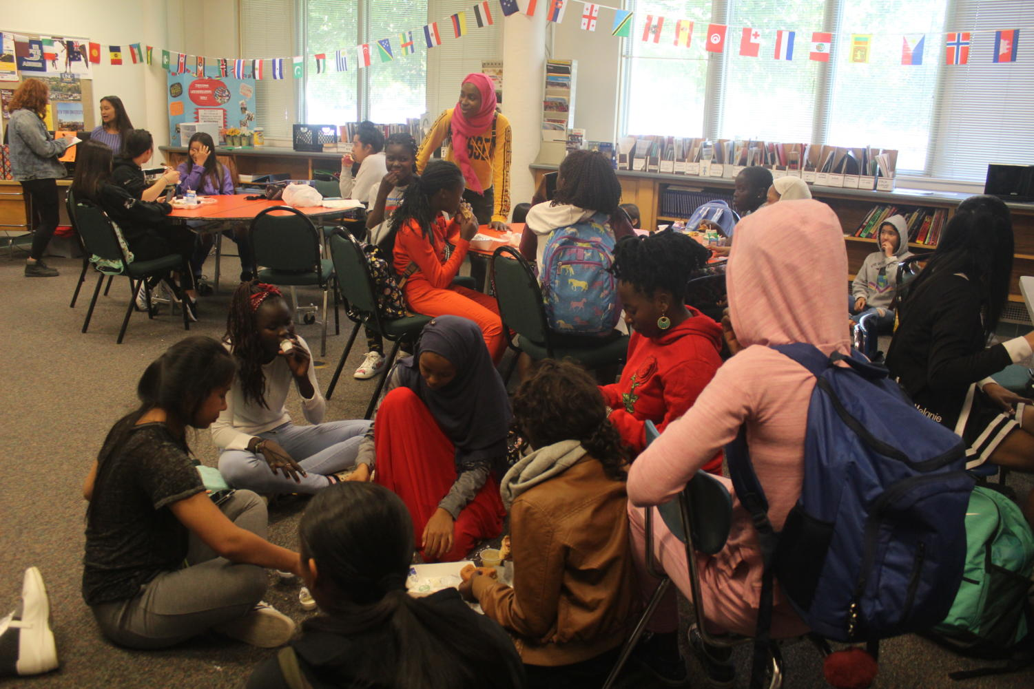 Some of the refugee students at Highland gather together in room D106