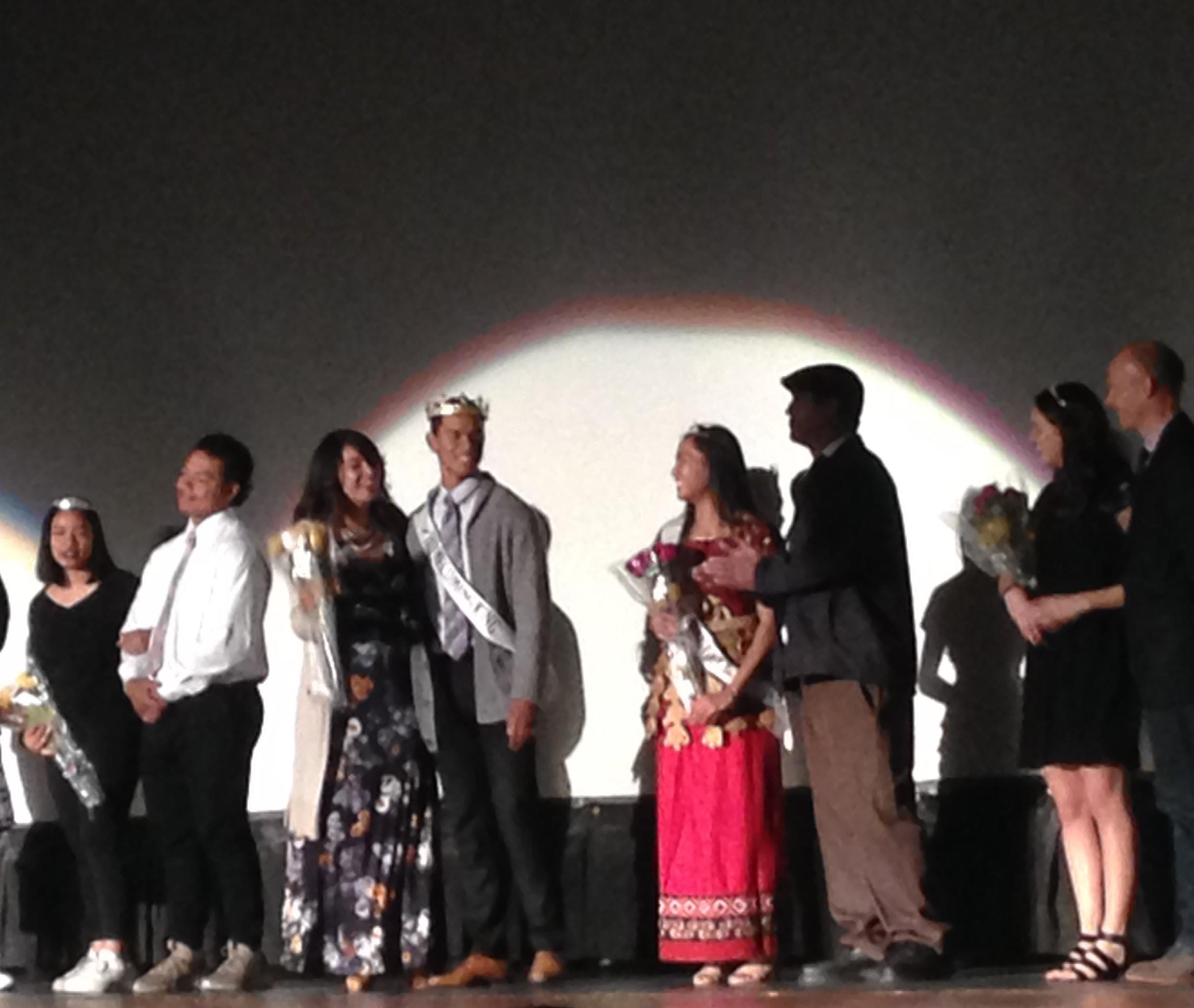 Bronson Olevao (fourth from the left) poses for pictures with his mom and all the other royalty  during Thursday's Homecoming assembly.