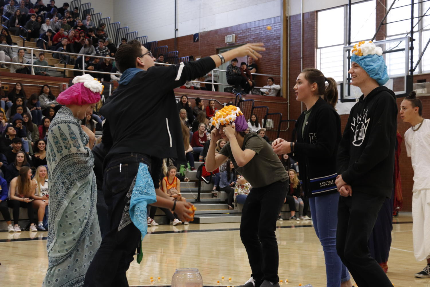 Students participate in  an activity during the Club Rush assembly.