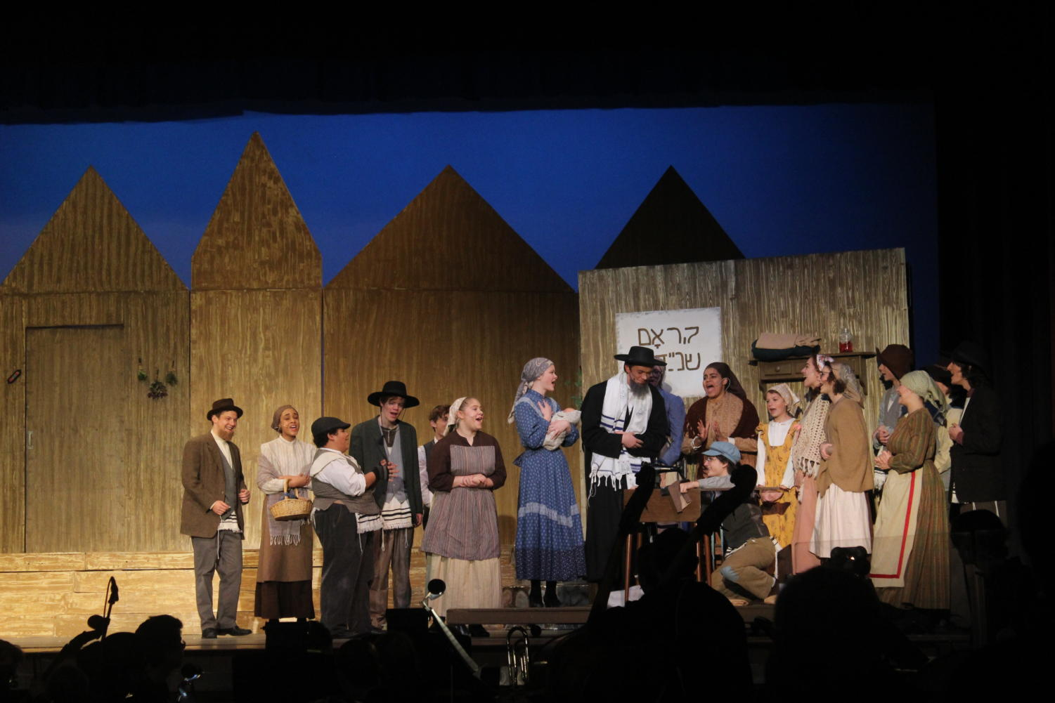 The cast of this year's musical perform during Fiddler on the Roof.
