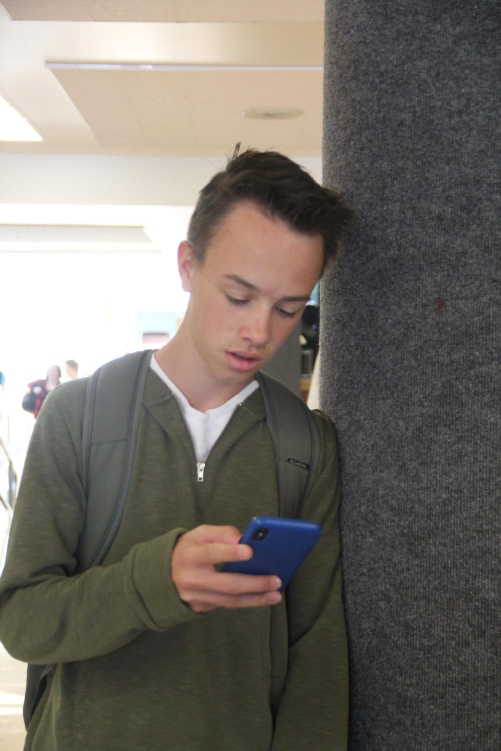 Wil Beasley looks at his phone, something teens are doing more frequently than ever.