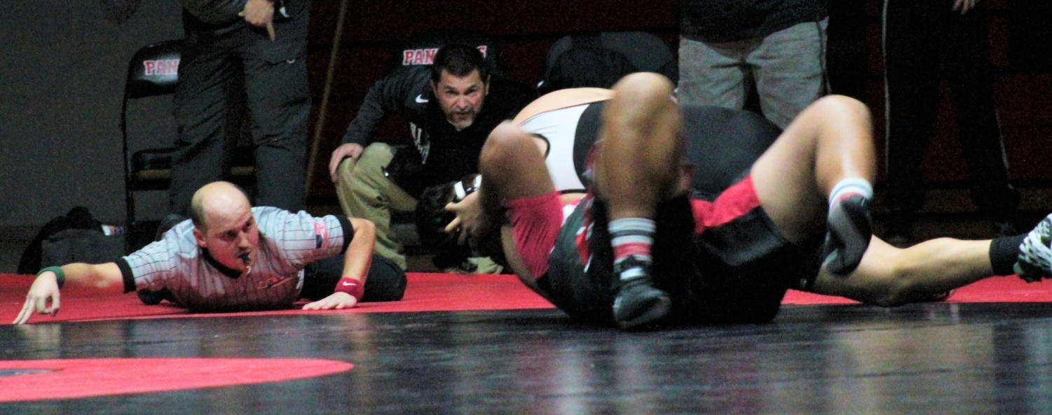 Highland wrestling coach Ted Sierer watches intently during a match vs. West High.