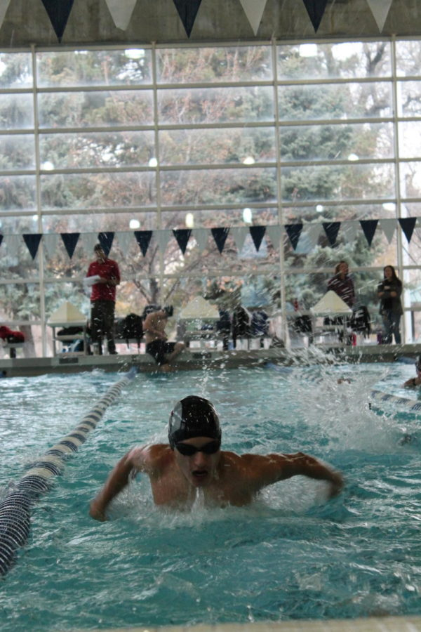 Jared Wright swims butterfly during practice.