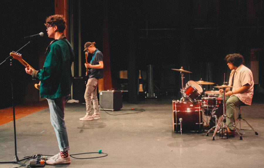 SLC band Blue Rain Boots perform their new single 2023 during the Talents and Traditions Assembly.