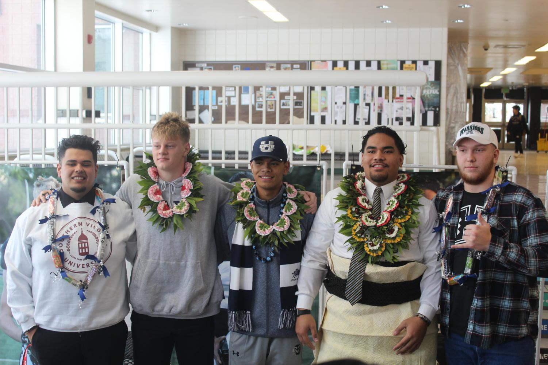 Athletes who signed (from left to right) Arturo Lagunas, Jackson Hawes, Bronson Olevao, Kaufusi Pakofe, and Caden Hilborn.