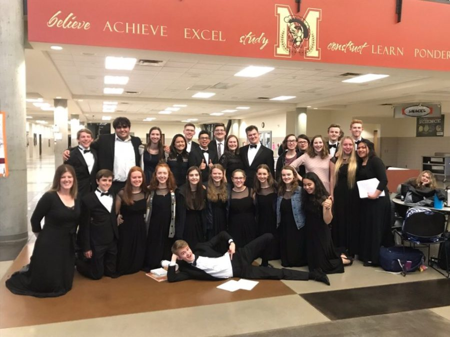 The+Madrigals+Choir%2C+along+with+director+Katie+Houston+-+kneeling+on+the+far+left%2C+pose+for+pictures+at+the+regions+competition.+