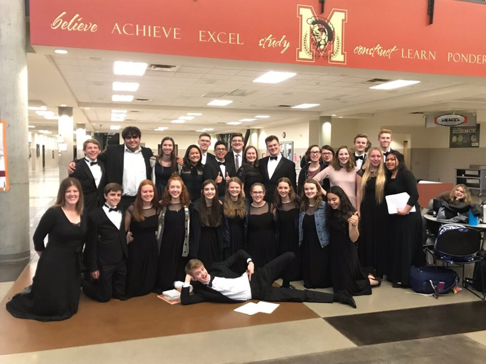 The Madrigals Choir, along with director Katie Houston - kneeling on the far left, pose for pictures at the regions competition.