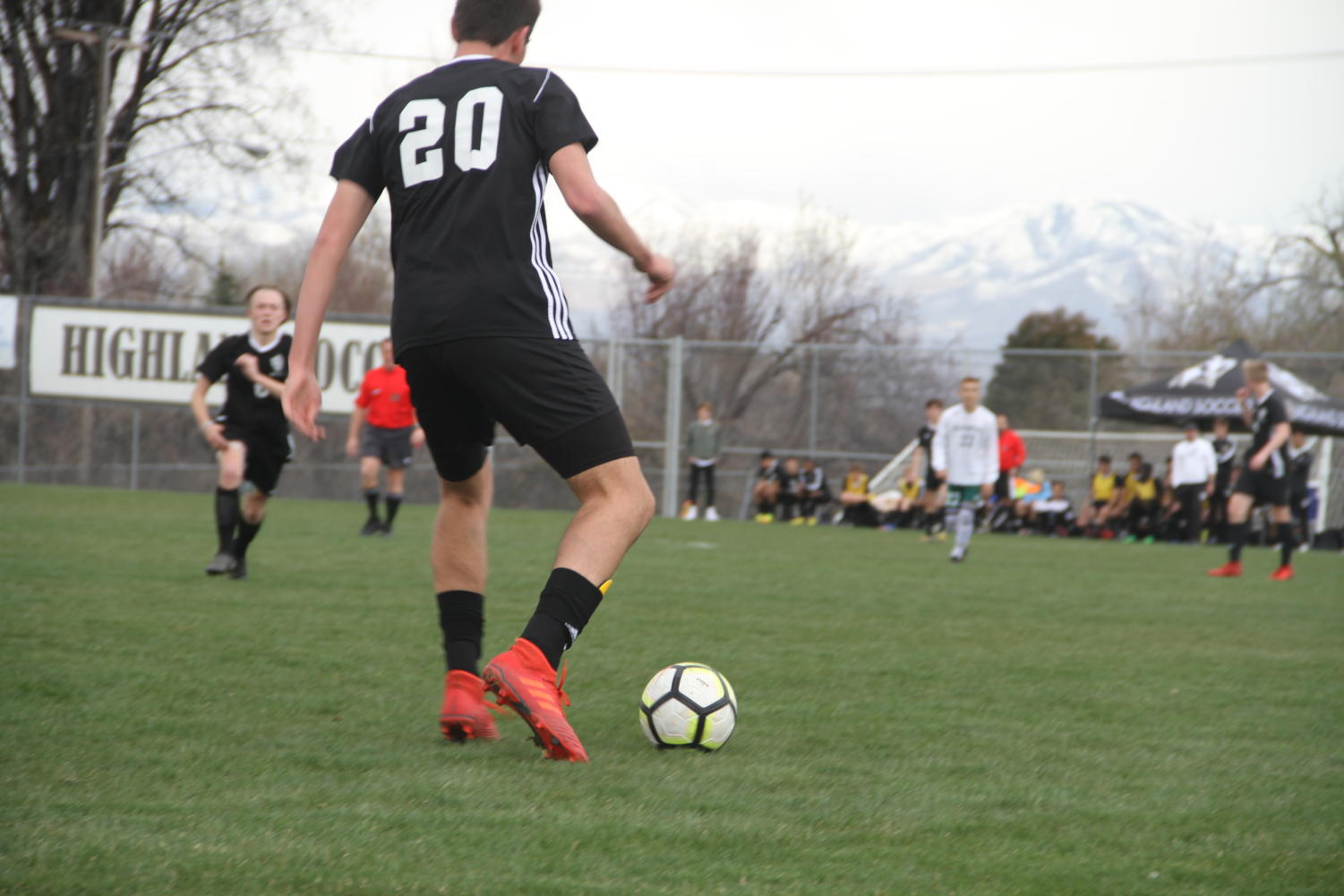 Highland's Owen Ross dribbles the ball up the field during the game against Olympus.