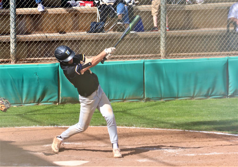 Highland Junior Andrew Thomas up to bat at the Highland vs. Murray baseball game.