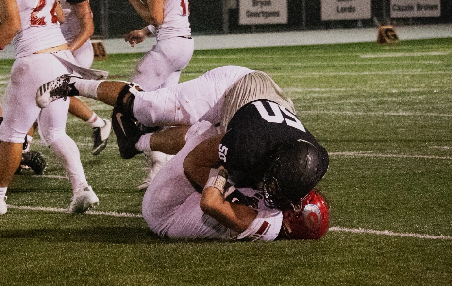 Rodrick Tialavea tackling a Granger player in earlier action this season.