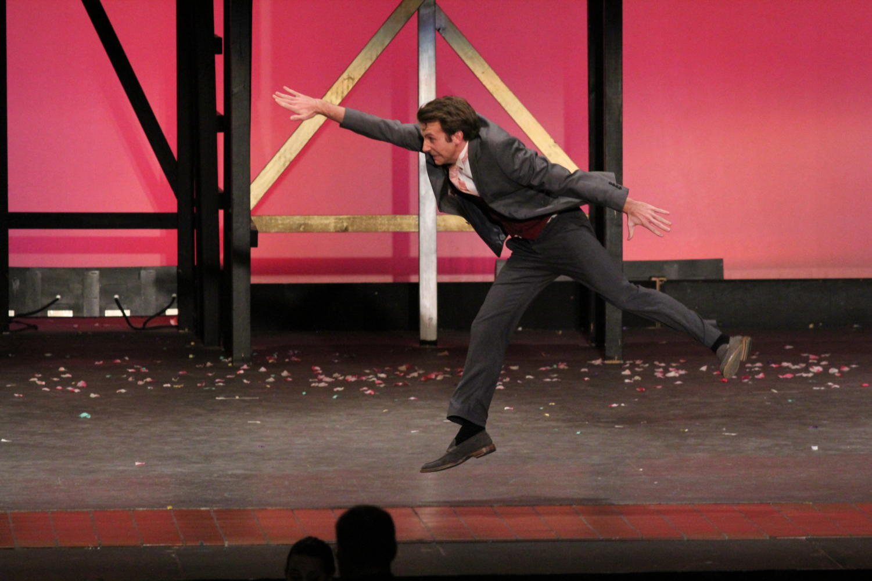 Jimmy Baton (Grayden) dances for the audience.