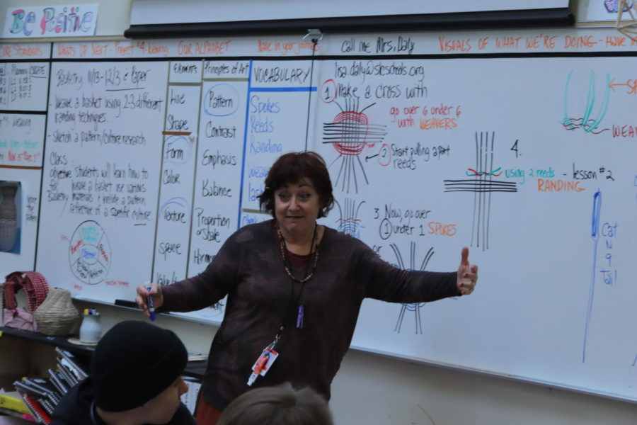 Lisa Daly teaching one of her art classes
