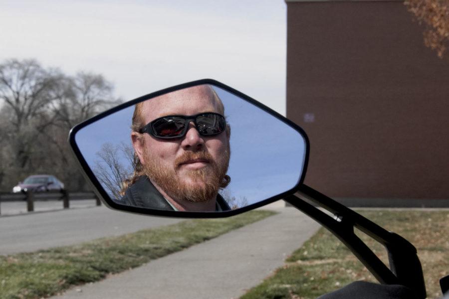 Steve Manwaring in the mirror of his motorcycle.