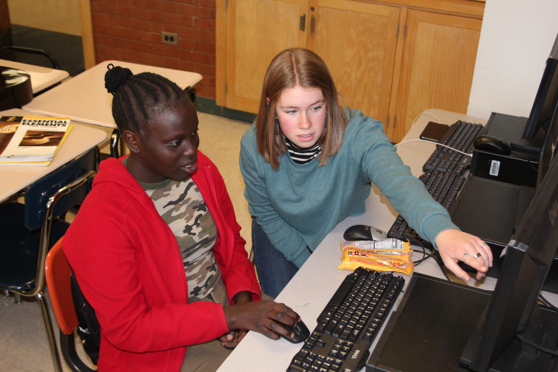 Mimi Reeder helping Joyce Elgadi on her essay during the Real Life tutoring program.
