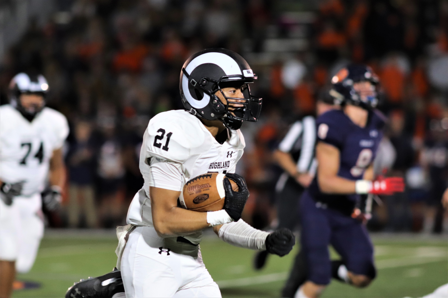 Highland football player goes for a touchdown.