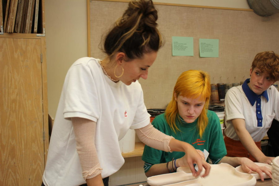 Blair Porter helps a student.