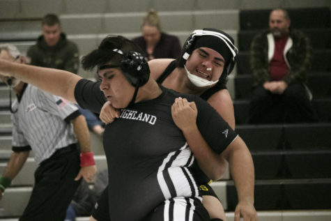 Jaime Dueñas wrestling against his opponent from Cottonwood High.