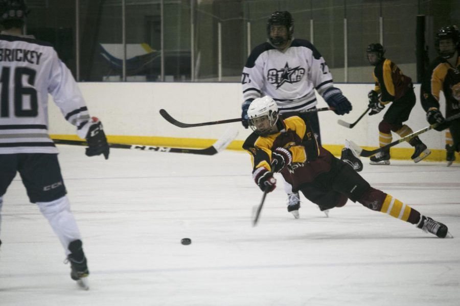 A UCI North player attempts to shoot a goal.