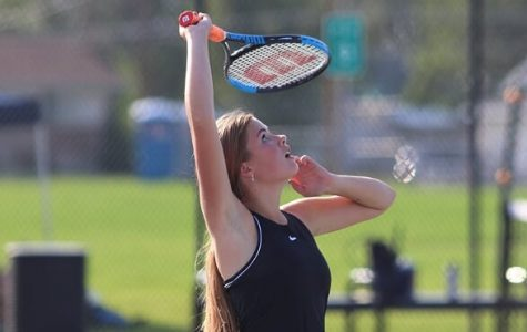 Emma Siepherd serving in a tennis match this season. The Varsity team took first place in region for the second year in a row.