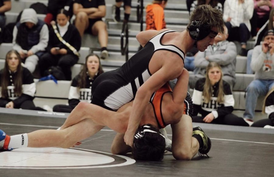 Connor Straessler wrestling at a home match last season.