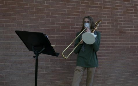 Lars Bartel, Highland senior, plays trombone at a live rehearsal.