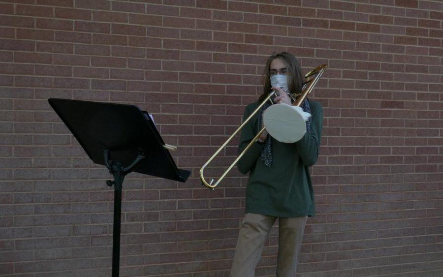 Lars+Bartel%2C+Highland+senior%2C+plays+trombone+at+a+live+rehearsal.+