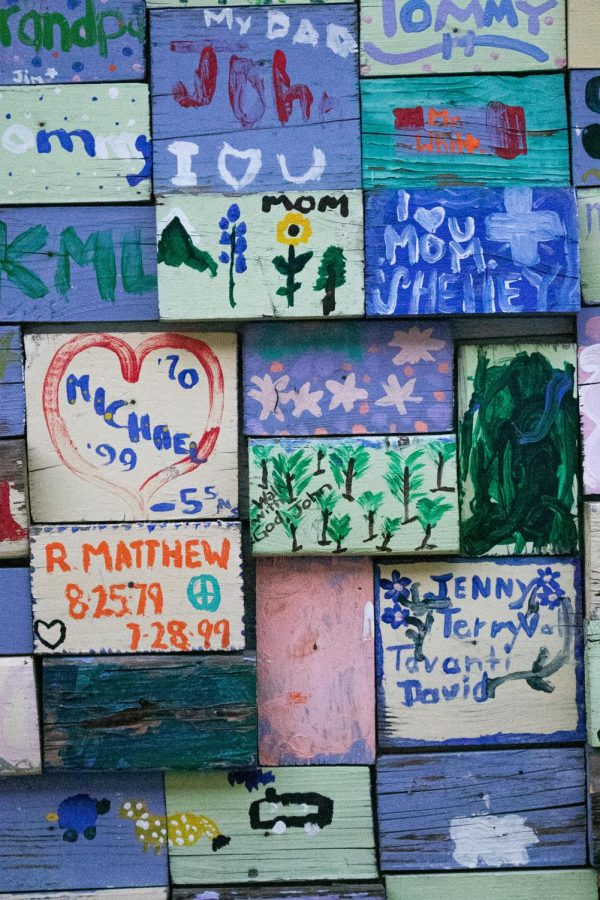 The memory wall outside of the Sharing Place honors families of members.
