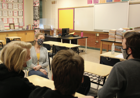 Becky Blommer talks to a group of her senior students on her last day of teaching at Highland.