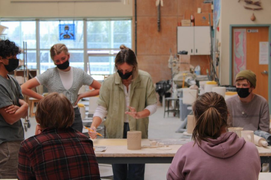 Teacher Blair Porter teaches a group of eager students in the ceramics studio.